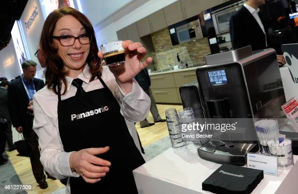 Panasonic spokesmodel Kelly Howard serves coffee freshly made from a Panasonic automatic coffee maker at the 2014 International CES at the Las Vegas...