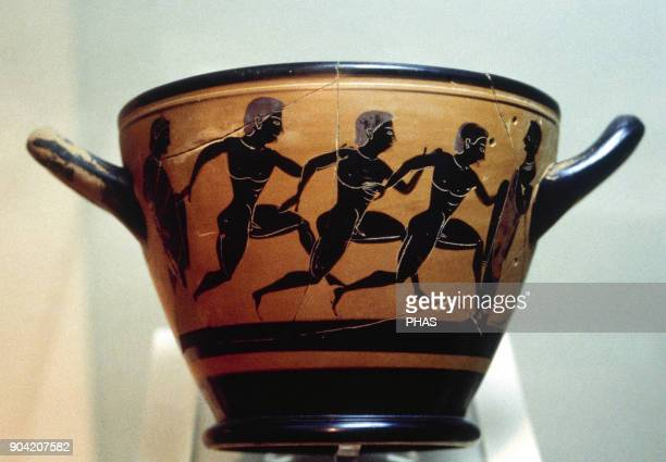 Panatenaic amphora Pottery Blackfigure decoration depicting three athletes running in sport competition Dated aorund 400 BC National Archaelogical...