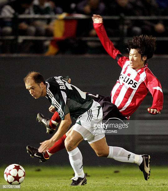 Panathinaikos' Aggelos Basinas fights for the ball with PSV Eindhoven's PyoYoung Lee during their group E European Champions League footbal game in...