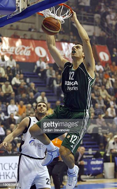 Panathinaikos Athens player Konstantinos Tsartsaris, right, slam dunk near Petar Bozic, left from Partizan during their group B Euroleague basketball...