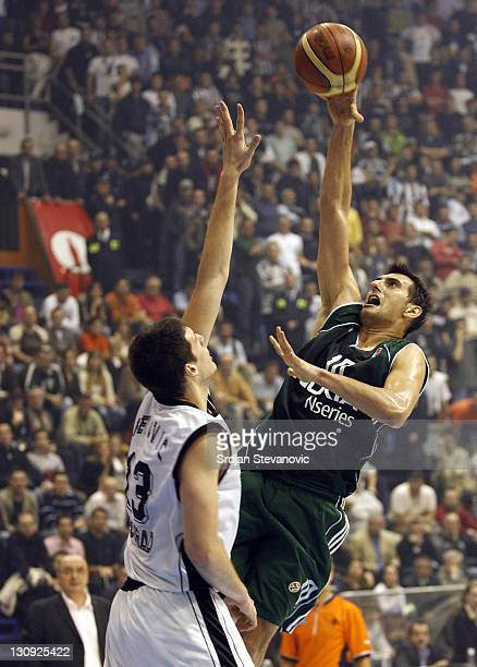 Panathinaikos Athens player Nikolaos Chatzivrettas, right,try to score over Kosta Perovic, left, from Partizan during their group B Euroleague...