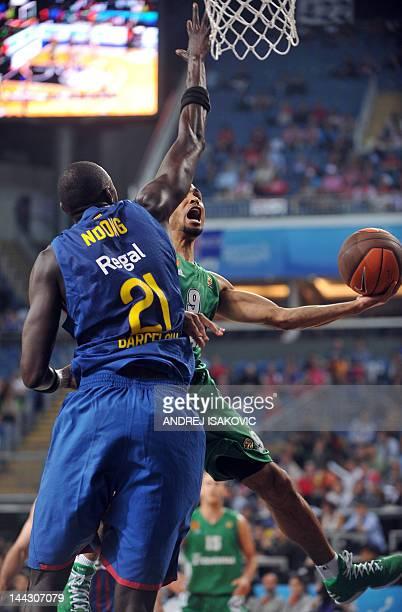 Panathinaikos' David Logan vies with Barcelona's Boniface Ndong during the Euroleague Final four basketball third place match between Panathinaikos...