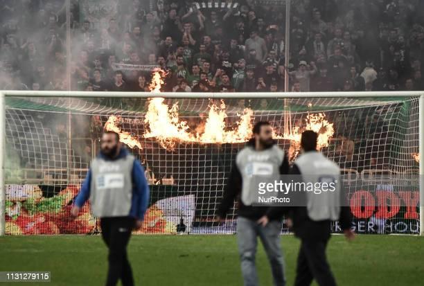 Panathinaikos fans burn a cloth banner during Greek Super League football match between Panathinaikos Athens and Olympiakos Piraeus at Olympic...