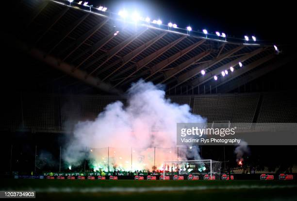 Panathinaikos fans light up signal flares during the Greece SuperLeague match between Panathinaikos FC and P.A.O.K. At OAKA Stadium on February 02,...