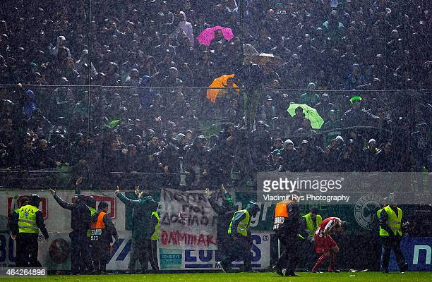 Panathinaikos fans throw objects on Jimmy Durmaz of Olympiacos during the Superleague match between Panathinaikos FC and Olympiacos at Apostolos...