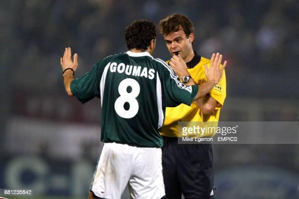 Panathinaikos' Giannis Goumas pleads his innocence to referee Jan Wegereef