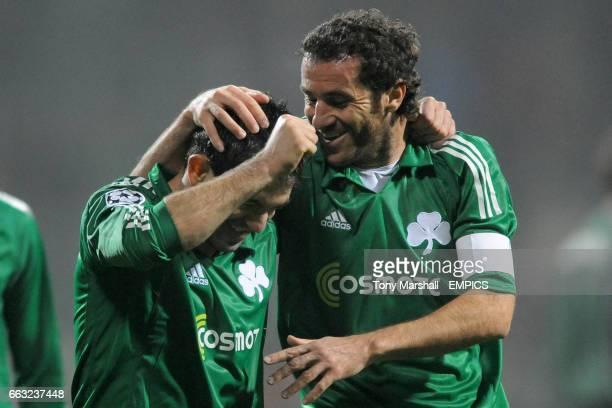Panathinaikos' Giorgios Karagounis and Giannis Goumas celebrate their teams win at the final whistle