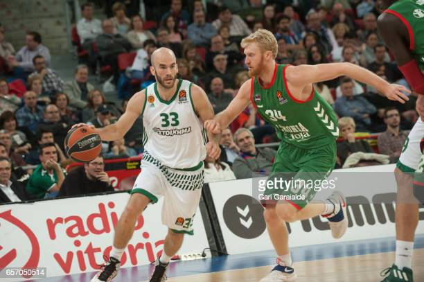 Panathinaiko's Greek guard Nick Calathes #33 vies with Baskonia's American forward Chase Budinger #34 during the Turkish Airlines Euroleague...