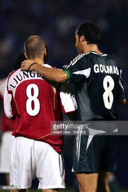 Panathinaikos' Ioannis Goumas and Arsenal's Fredrik Ljungberg shake hands at the final whistle