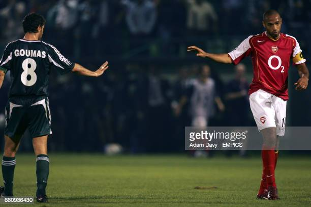 Panathinaikos' Ioannis Goumas and Arsenal's Thierry Henry apologise to one another