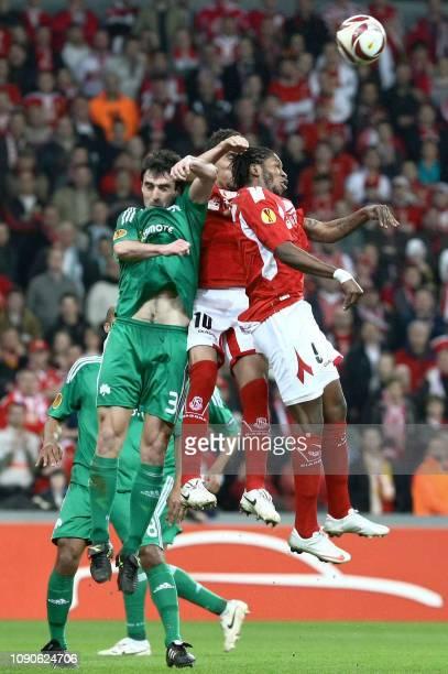 Panathinaikos' Josu Sarriegi and Standard's Igor De Camargo and Dieumerci Mbokani fight for the ball during the return game of the EUFA Europa League...