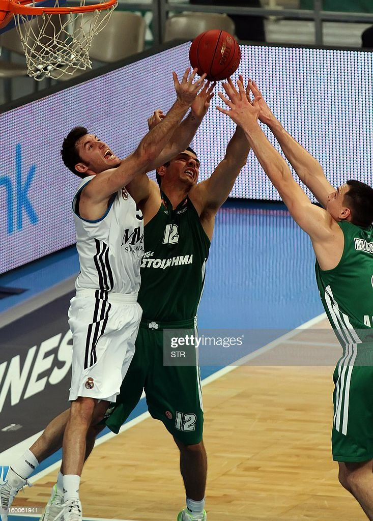 Panathinaikos' Kostas Tsartsaris (C) jumps for a rebound with Rudy Fernandez of Real Madrid during their Euroleague top 16 basketball game in Athens on January 25, 2013.