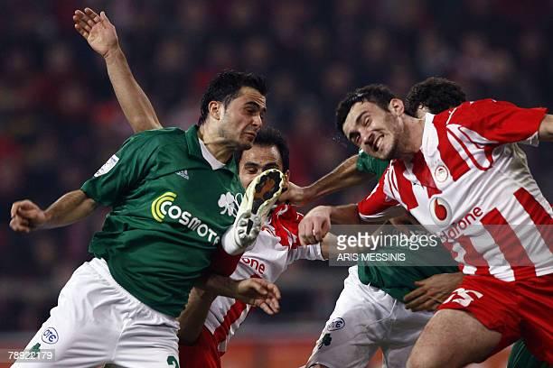 Panathinaikos' Loukas Vyntra challenges with Olympiakos' Christos Patsatzoglou and teammate Vassilis Torosidis during their Greek super League...