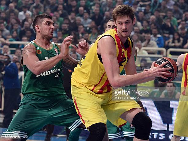 Panathinaikos player Batista Esteban tries to block Barcelona's German center Tibor Pleiss during their Euroleague top 16 basketball match at the...