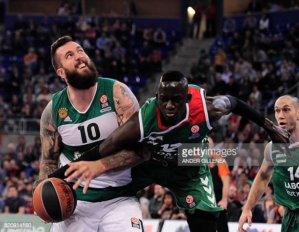 Panathinaikos' Serbian center Miroslav Raduljica vies with Laboral Kutxa's center Ilimane Diop during the Euroleague group basketball playoff match...