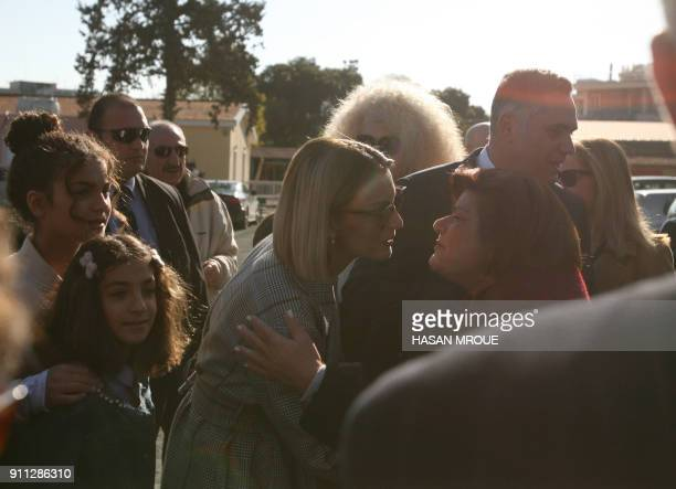 Panayiota the wife of Nikolas Papadopoulos the son of a former president of Cyprus and candidate in the 2018 presidential election is greeted outside...