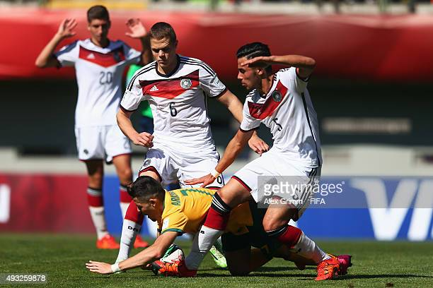 Panayioti Armenakas of Australia is challenged by Erdinc Karakas Joel Abu Hanna and Vitaly Janelt of Germany during the FIFA U17 World Cup Chile 2015...