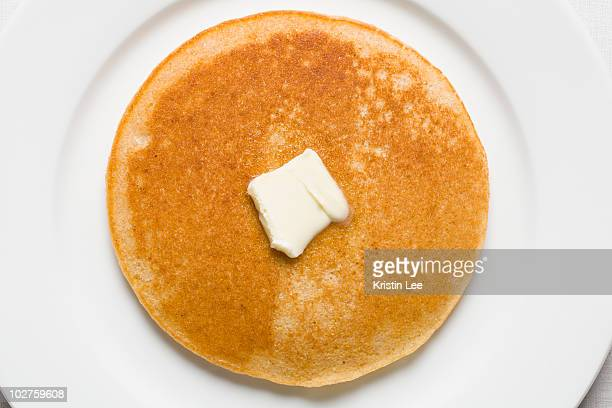 pancake and butter on plate - pancake stock pictures, royalty-free photos & images