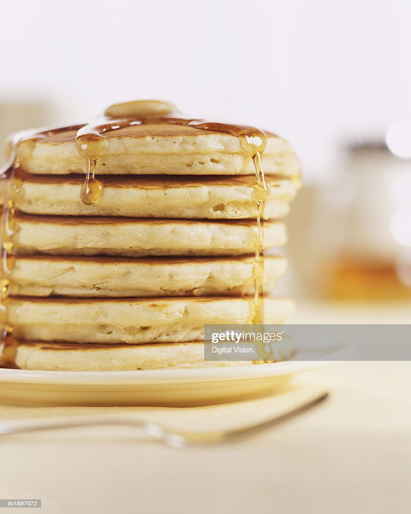Pancakes and Melting Maple Syrup : Stock Photo