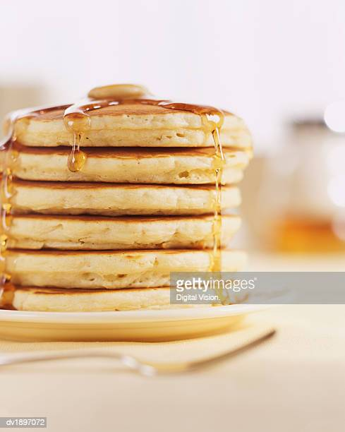pancakes and melting maple syrup - pancake stock pictures, royalty-free photos & images
