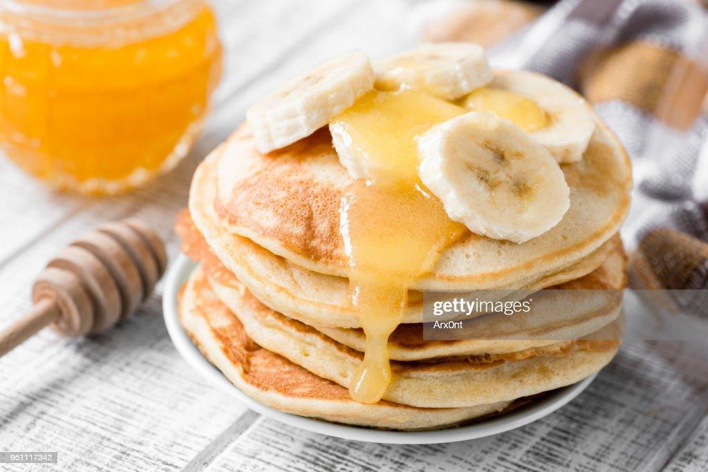 Pancakes with banana and honey : Stock Photo