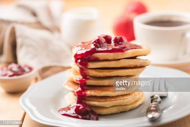pancakes with berry sauce and coffee breakfast - pancake stock pictures, royalty-free photos & images