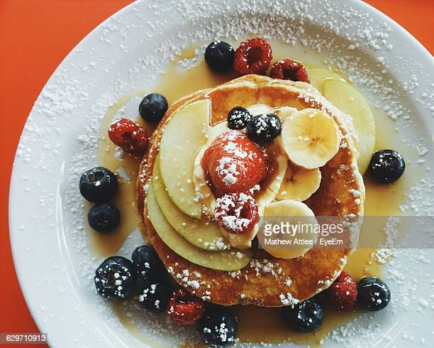 Pancakes With Fresh Fruit And Maple Syrup
