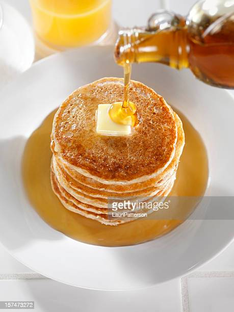 pancakes with maple syrup and butter - syrup stock pictures, royalty-free photos & images