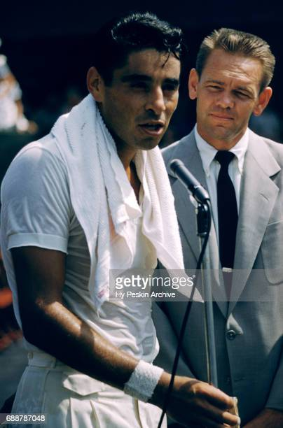 Pancho Gonzales of the United States and former player Jack Kramer stand at a microphone during a tournament arranged by Kramer circa 1957 in Los...