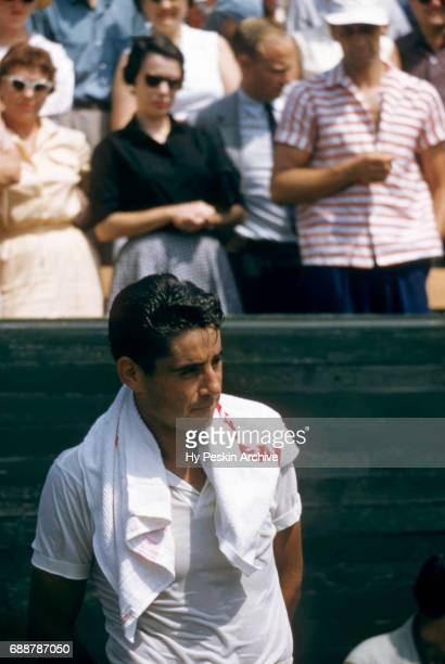 Pancho Gonzales of the United States stands on the sidelines during a tournament arranged by Kramer circa 1957 in Los Angeles California