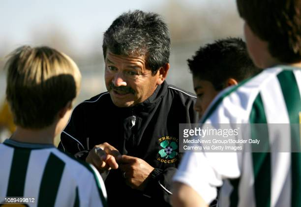 Pancho Hansen director for Lafayette Peak to Peak Athletics gives members of his Trebol soccer team last minute directions before the game on...