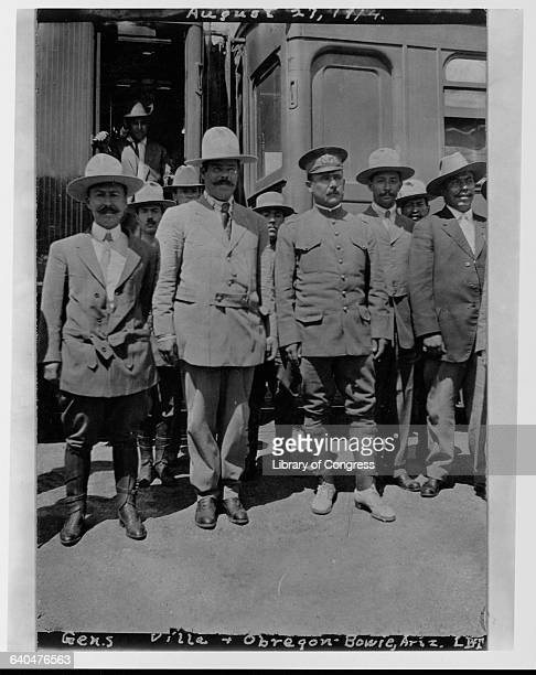Pancho Villa a Mexican revolutionary who became Governor of the State of Chihuahua in 1913 stands with Alvaro Obregon a soldier and a statesman who...