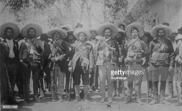 Pancho Villa and His bandits with bandoliers and guns