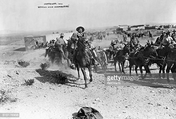Pancho Villa Galloping along his column. Photograph 1914. BPA2# 4144