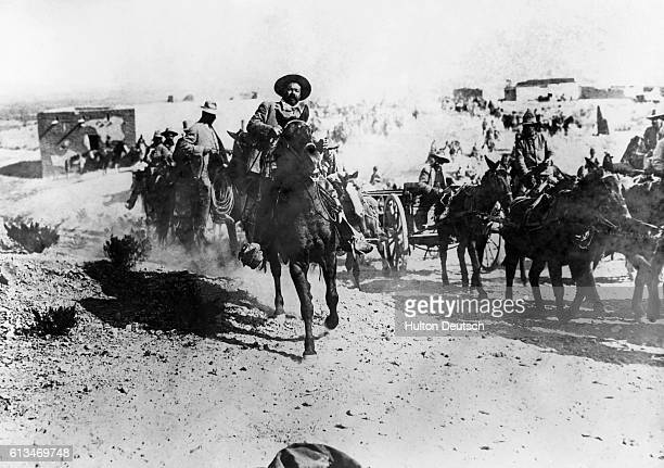 Pancho Villa leads other Mexican rebels on horseback