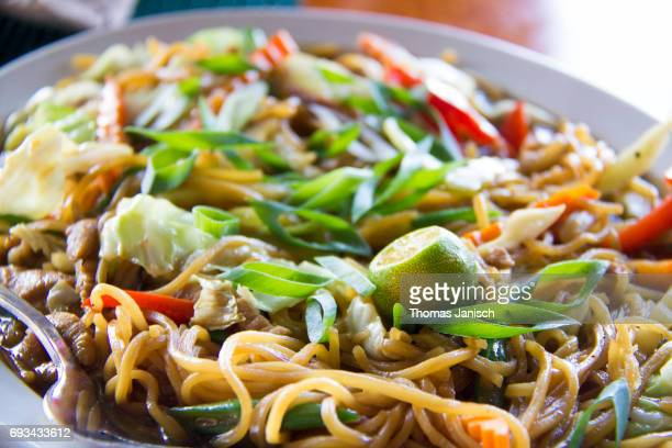 pancit canton, a traditional filipino meal - filipino culture stock photos and pictures