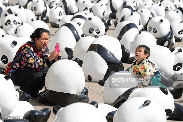 280 panda sculptures are displayed in front of a shopping mall for promoting environmental protection on April 22 2015 in Taiyuan China A shopping...