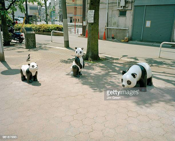 Panda sculptures in a public square