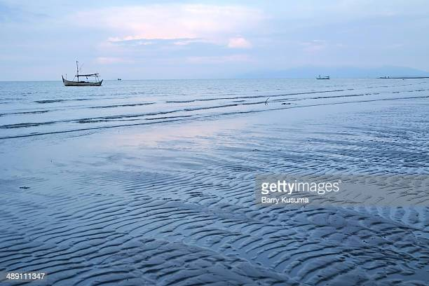 pandean beach banyuwangi - east java province stock photos and pictures