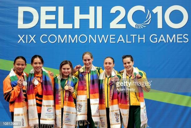 Pandelela Pamg and Mun Yee Leong of Malaysia Melissa Wu and Alexandra Croak of Australia and Briony Cole and Anabelle Smith of Australia pose with...