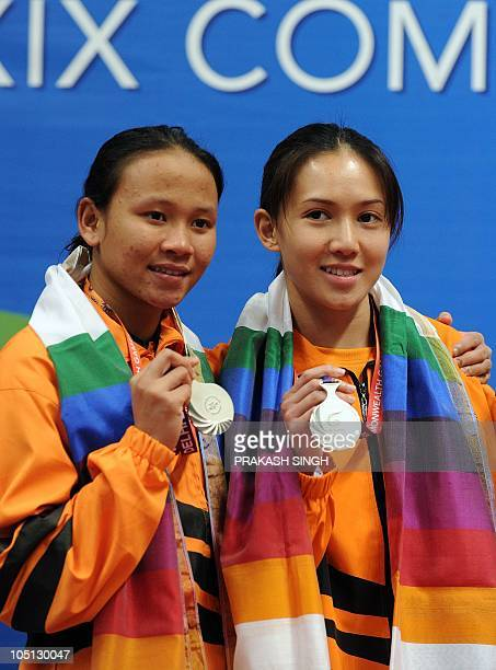 Pandelela Rinong Pamg and Mun Yee Leong of Malaysia pose during the medal ceremony after winning the Silver in the Final of Women's 10M Synchro...