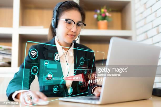 covid-19 pandemic coronavirus  , portrait of asian successful business woman working on laptop at home and social distancing. - hud interfaccia grafica utente foto e immagini stock