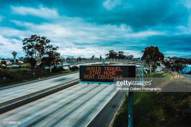 covid-19 pandemic, freeway message - forbidden stock pictures, royalty-free photos & images