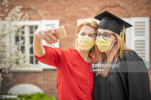 pandemic grad mother and daughter selfie - mask joke stock pictures, royalty-free photos & images