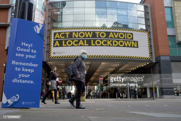 Pandemic lockdown warning sign is displayed to shoppers on October 07, 2020 in Manchester, England. Manchester now has the highest coronavirus...