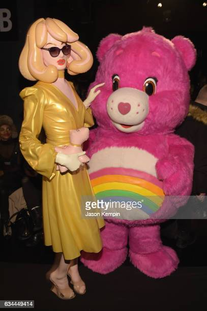 Pandemonia the Blow Up Doll and Cheer Bear of the Care Bears attend the Michael Costello fashion show during New York Fashion Week: The Shows at...