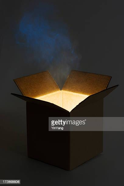 pandora box open with mysterious glowing magic gift - mystery stock pictures, royalty-free photos & images