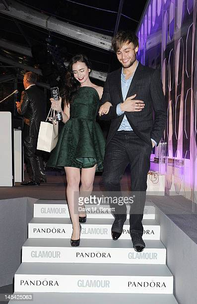 Pandora Breakthrough Of The Year Lily Collins and presenter Douglas Booth pose in front of the winners boards at the Glamour Women of the Year Awards...