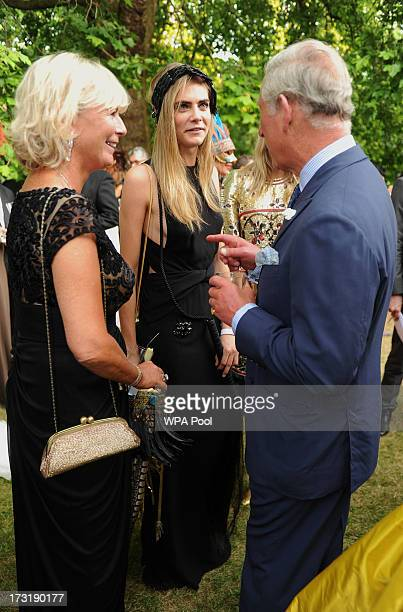 Pandora Delevingne and daughter model Cara Delevingne meet with Prince Charles Prince of Wales as they attend a reception hosted by The Prince of...