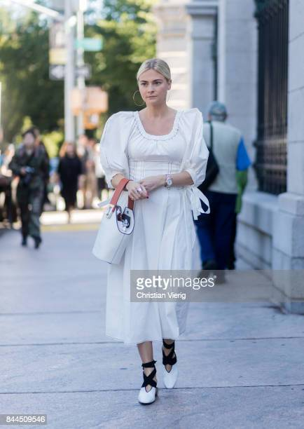 Pandora Skies wearing a white dress seen in the streets of Manhattan outside Tory Burch during New York Fashion Week on September 8, 2017 in New York...